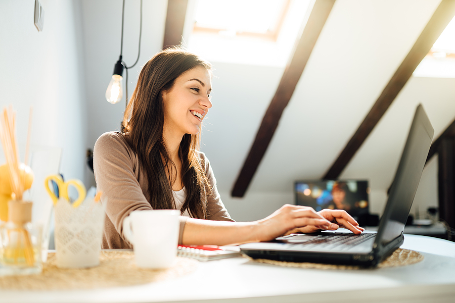 Business woman working from home on laptop computer.Checking email.Working from distance.Online business career.Writer editor.Quarantined office employee using laptop.Freelance worker.Home office