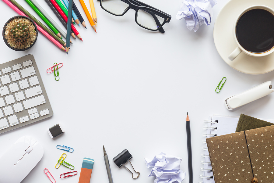 Top view of an desk office table. White office desk top with cup of coffee. Working on desk and office space. Office supplies and gadgets on desk top table. Desk top working and business concept. Office working atmosphere, Top view flat lay
